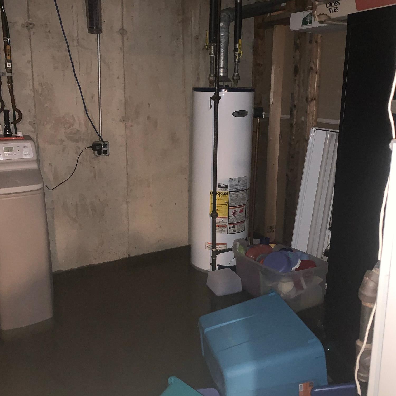 flooded basement. standing water in basement around water heater.