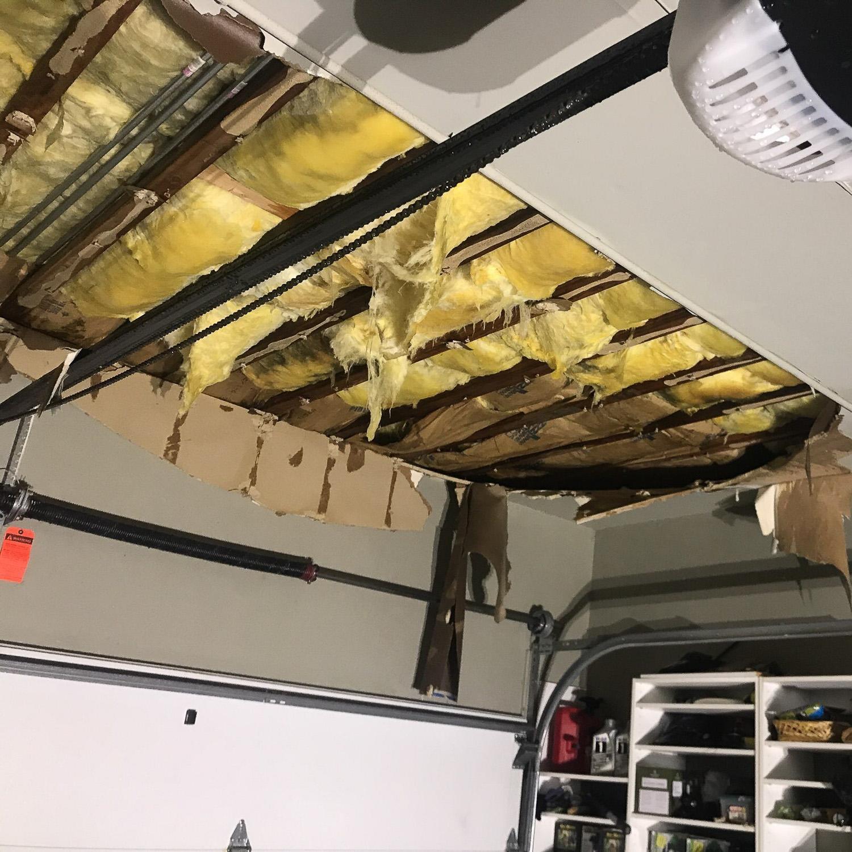 water damaged garage ceiling before water damage restoration
