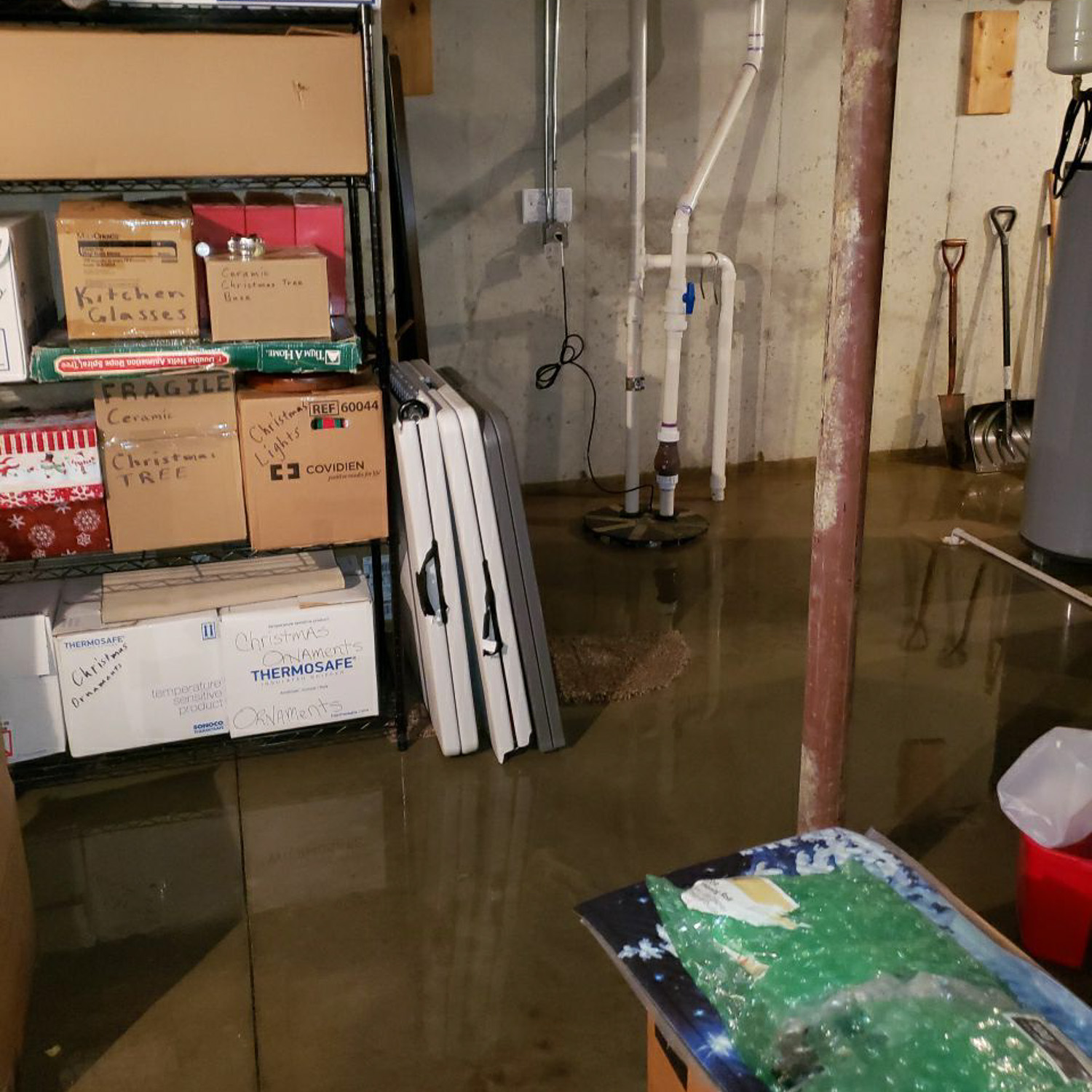 flooded basement before water damage restoration - sump pump failure
