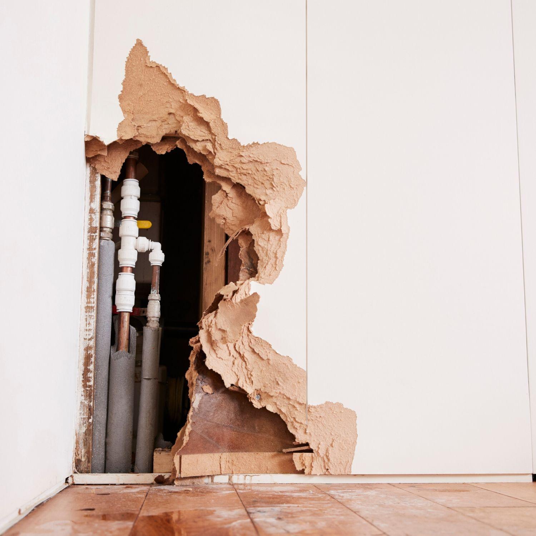 water damaged wall before damage restoration