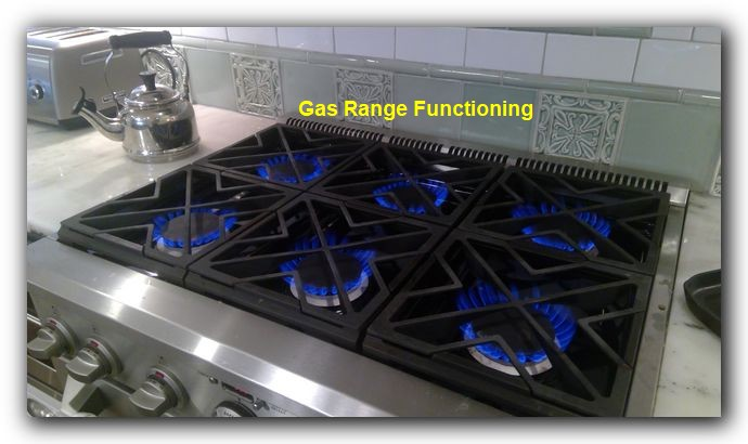 inspecting gas stove during home inspection