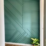 Entryway accent wall with a random geometric wainscoting
