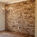 brick accent wall in a dining room