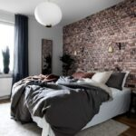 brick accent wall in bedroom