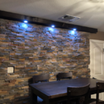 Stone veneer wall in dining room in texas
