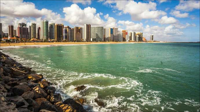 Aquamarine waves meet the shore at Mucuripe Beach, Fortaleza Brazil.