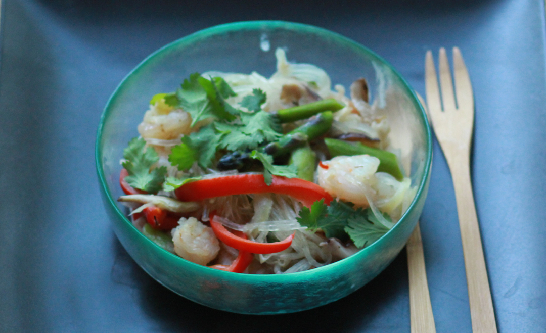 a bowl of noodles shiitake and shrimp