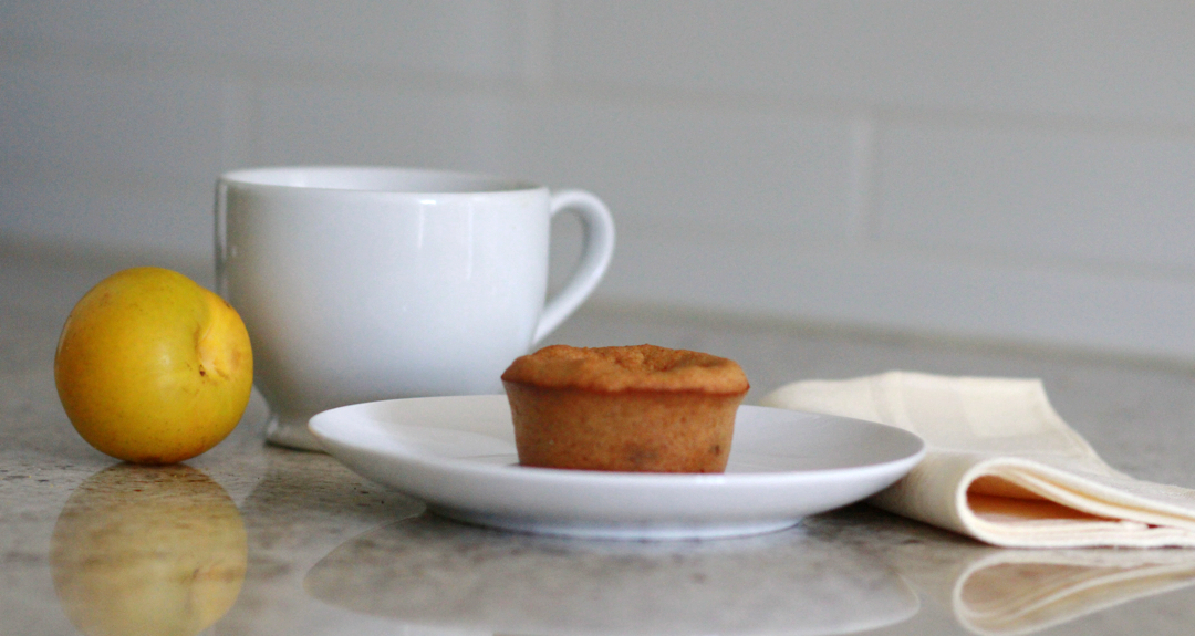 Banana muffins on a plate, a cup and a plumb