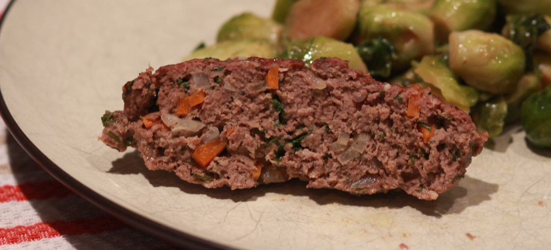 A piece of meatloaf on a plate