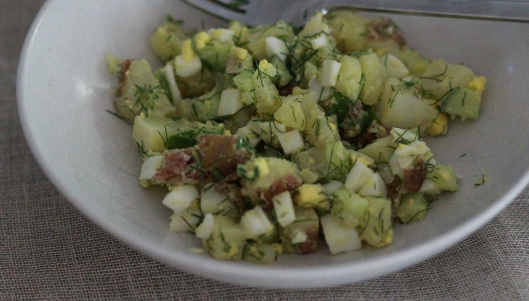 white bowl with potato salad