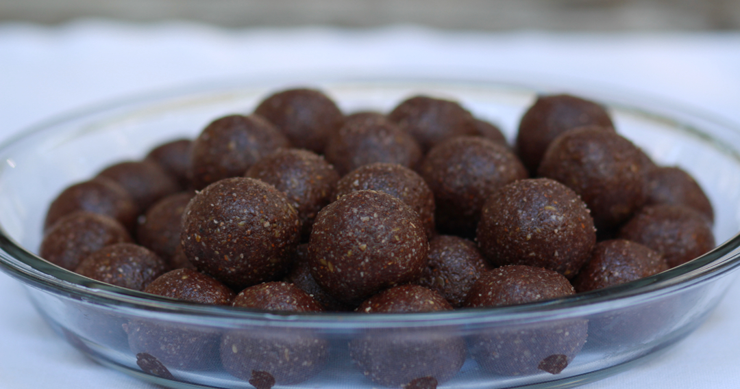 a plate of chocolate bombs, in a shape of balls