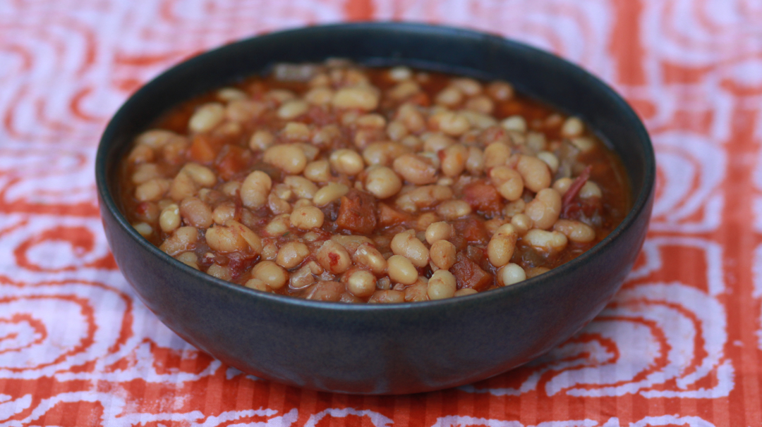 a bowl of beans on a bright background