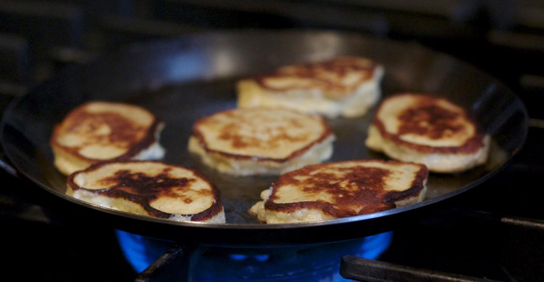 Banana pancakes in a frying pan