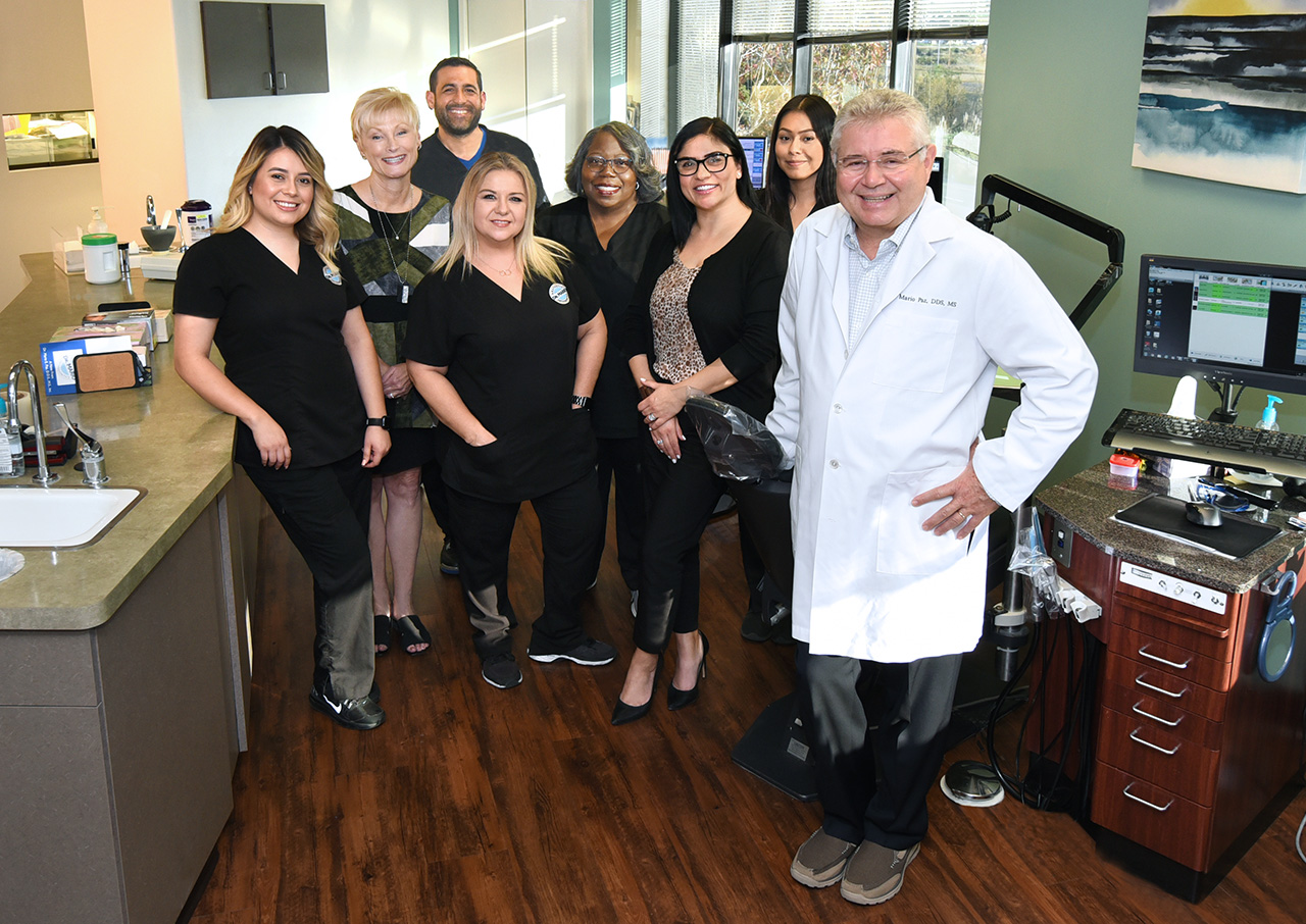 Dr. Mario Paz, DDS and his orthodontics team