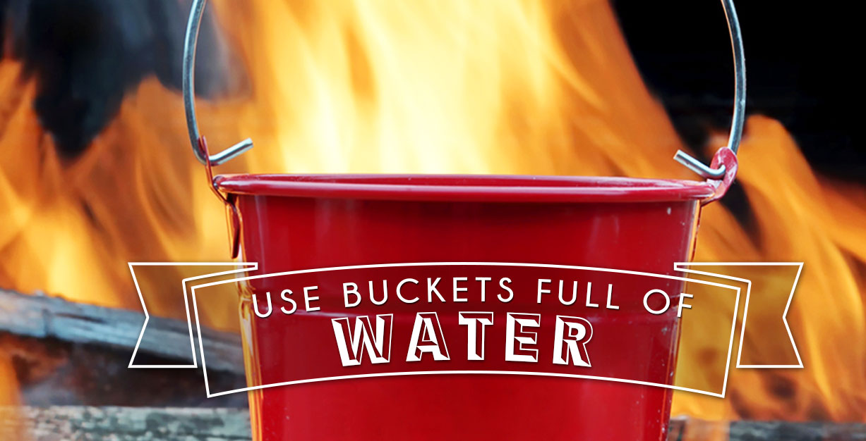 Use buckets of water to put out a fire pit.
