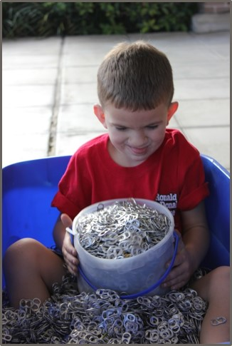 boy collecting pop tabs