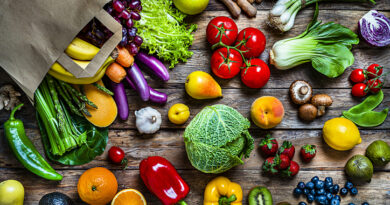 Colorful vegetables and fruits spilling out of shopping bag