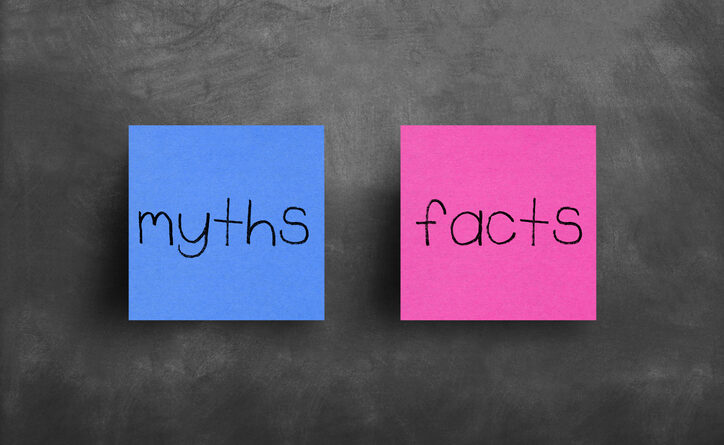 "Two sticky notes on a blackboard; ""myths"" and ""facts"""