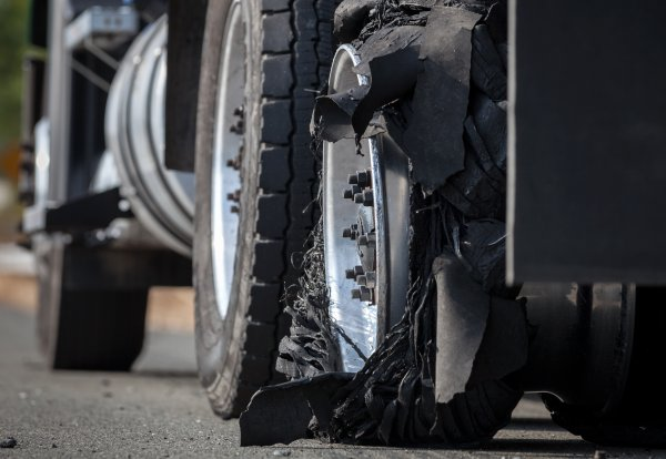 Semi Truck Tire Blowout on Highway
