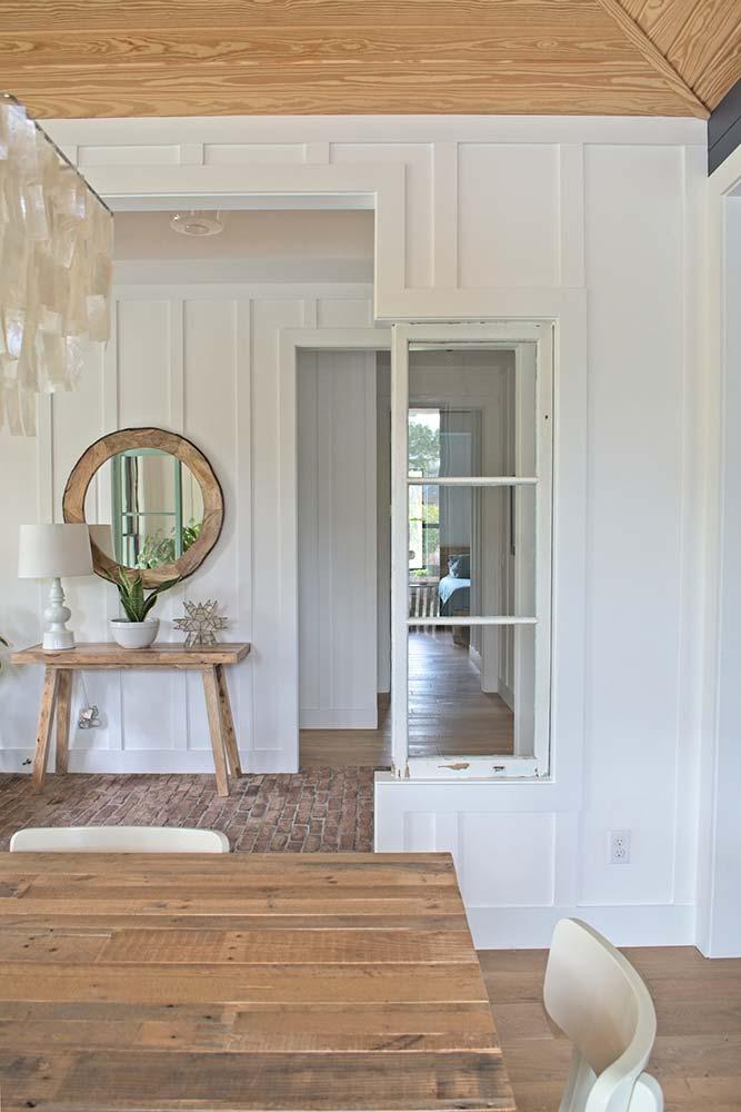 modern farmhouse, interior design, dining room, foyer, brick floor, wood floor round mirror, board and batten