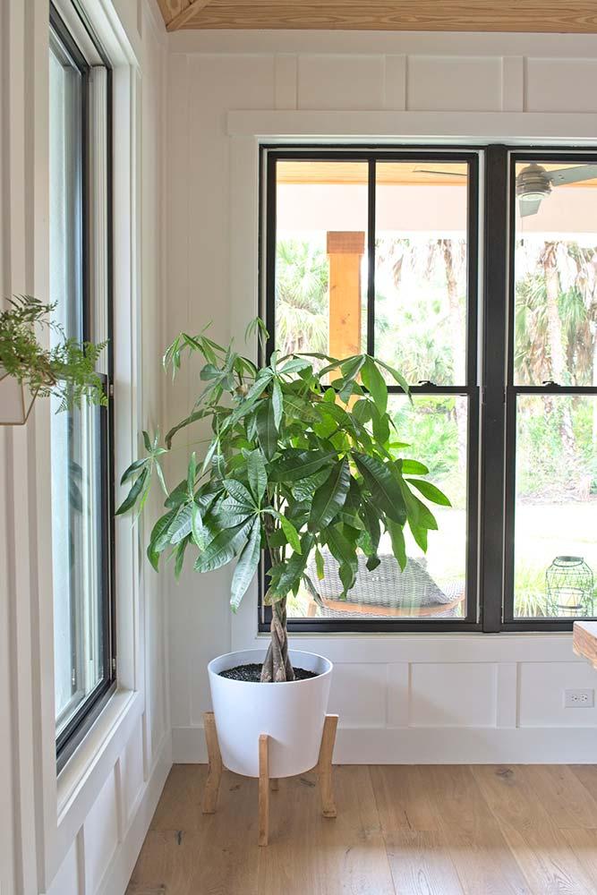 modern farmhouse, interior design, dining room, foyer, brick floor, wood floor round mirror, board and batten, money tree, mid century modern planter