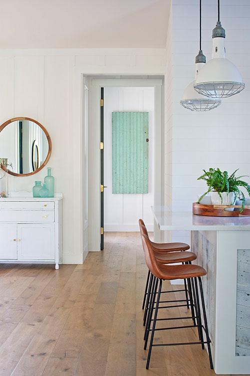 modern farmhouse, farmhouse kitchen, kitchen design, wood floors, barstools, round mirror, shiplap