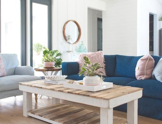 modern farmhouse living room navy blue sofa couch rectangle coffee table armchair ikea board and batten round mirror