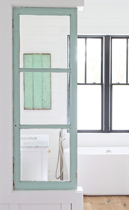 farmhouse bathroom, white walls, freestanding tub, architectural salvage, antique windows, black windows