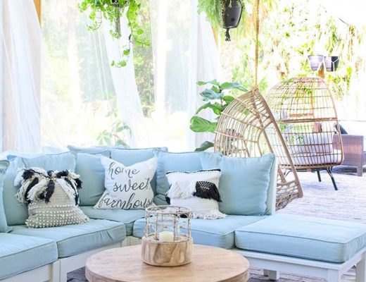 bohemian design, boho style porch, outdoor sectional, pottery barn outdoor sofa, hanging plants, hanging egg chair