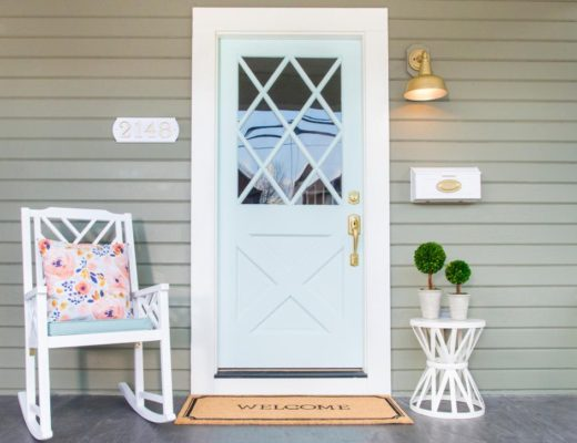 front porch curb appeal rocking chair brass wall sconce door mat mint green front door
