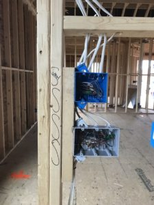 Notice the wire is all snug against the 2x4's as you look through the house.