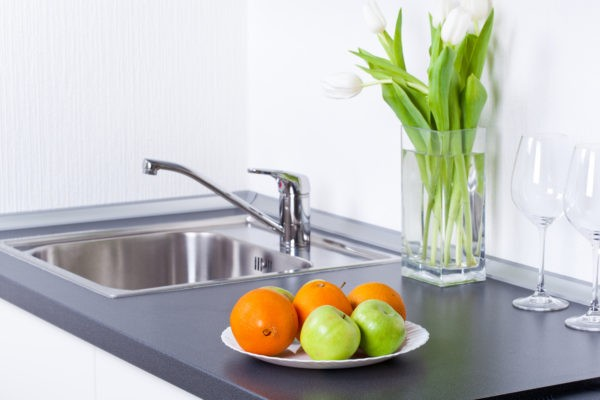 Healthy lifestyle, apples and oranges in white interior kitchen