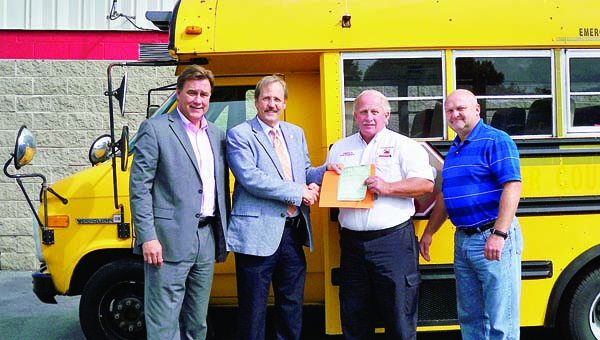 Star Photo/Abby Morris-Frye The Carter County School system has donated a Class A mini bus to the Carter County Sheriff's Department to be used for inmate work programs. Here, from…<p class=