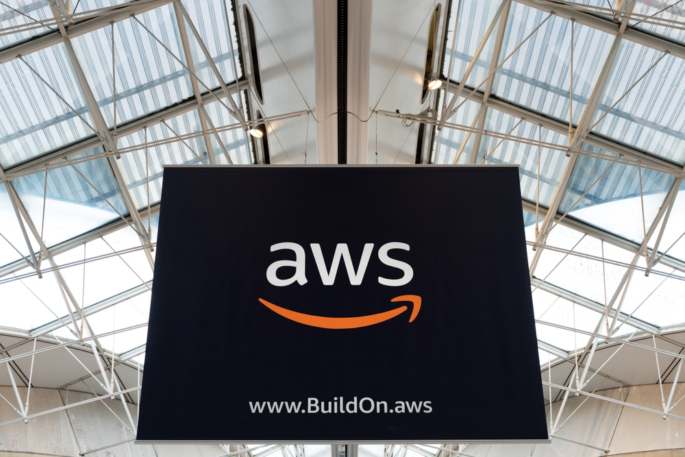 AWS amazon cloud services brand logo at Charles de Gaule Paris airport boarding area, big advertisement