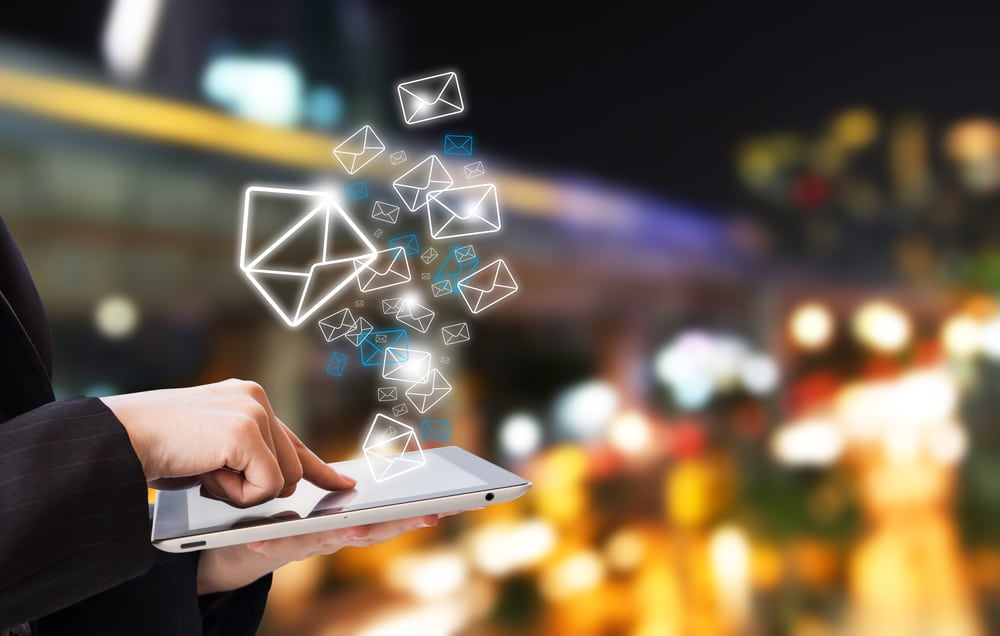 Businesswoman sending email by using digital tablet
