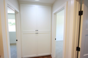 White painted shaker laundry cabinets