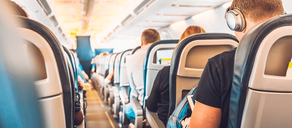 Man listening to music while on airplane