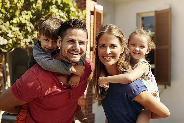 happy-family-outside-home