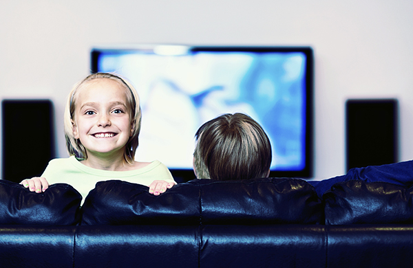 little-girl-in-front-of-home-theater