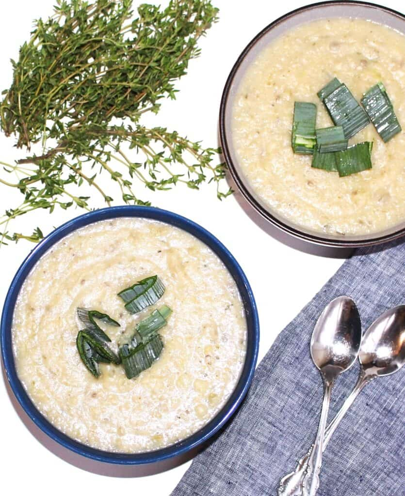 Two bowls of vegan potato leek soup
