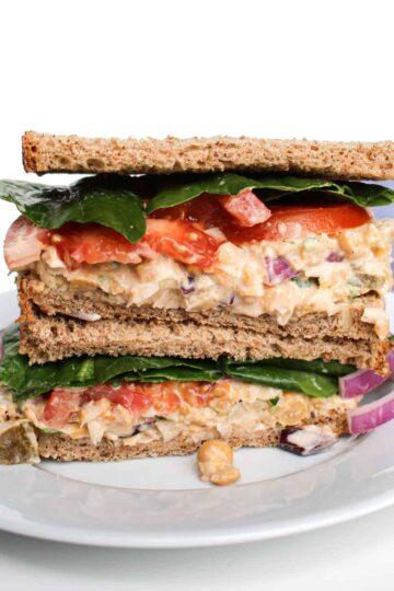 Chickpea tuna salad sandwich served on a white plate