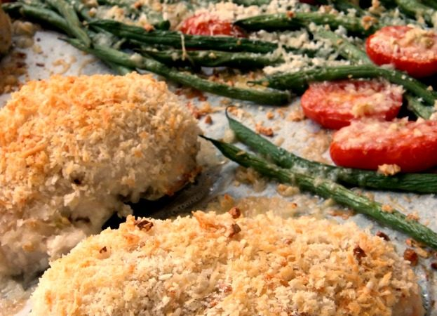 Parmesan Crusted Chicken is a favorite home cooked busy weeknight meal. This 5 ingredient recipe takes only 20 minutes to make. It is a gluten free recipe and is 21 day fix approved. Also makes a fabulous sheet pan dinner! #chickendinner #weeknightmeal #glutenfreerecipe #5ingredientrecipe