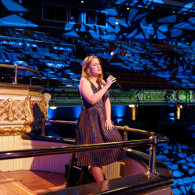 musician performs in theatre balcony