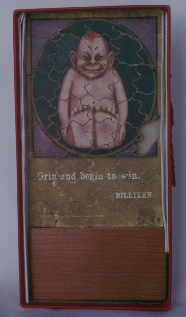 Jigsaw puzzle of cardboard, five and a half by three and a half inches. 1908.