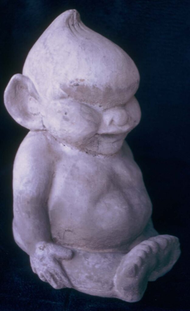 Billiken Figurine carved from whale jaw bone, three inches high. About 1960. Provenience unknown.