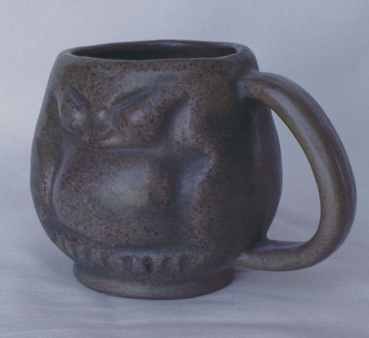 Pottery mug, three and an eighth inches high. Made by Tundra Pottery