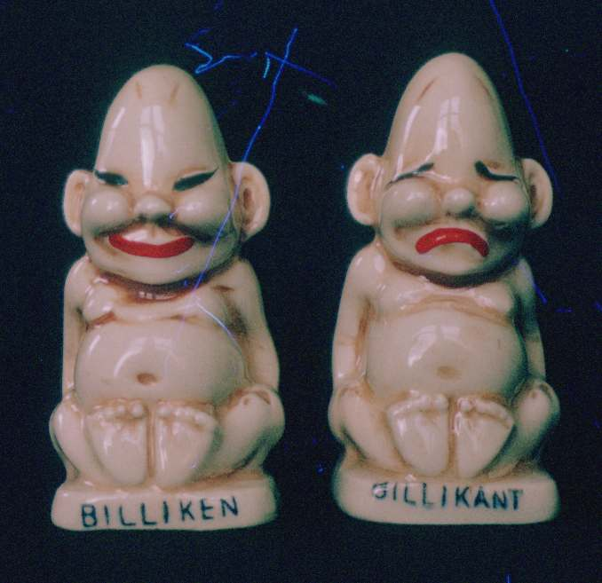 Salt and pepper shakers. Ceramic, three and a half inches high. Made in Japan.
