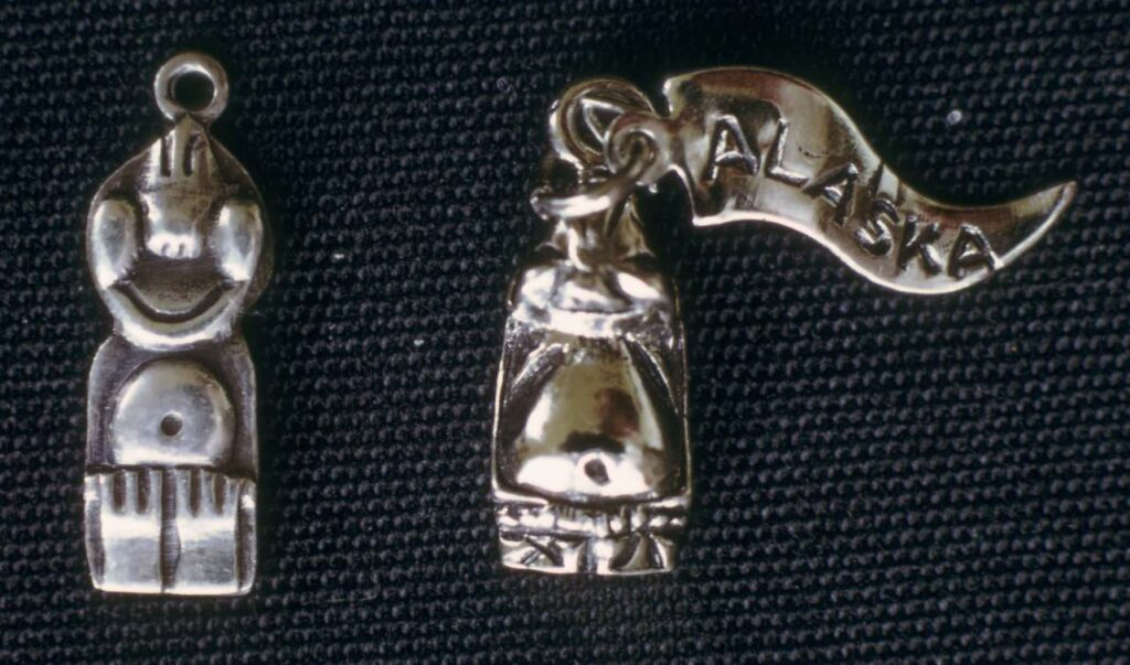 Sterling silver charm, 1973.