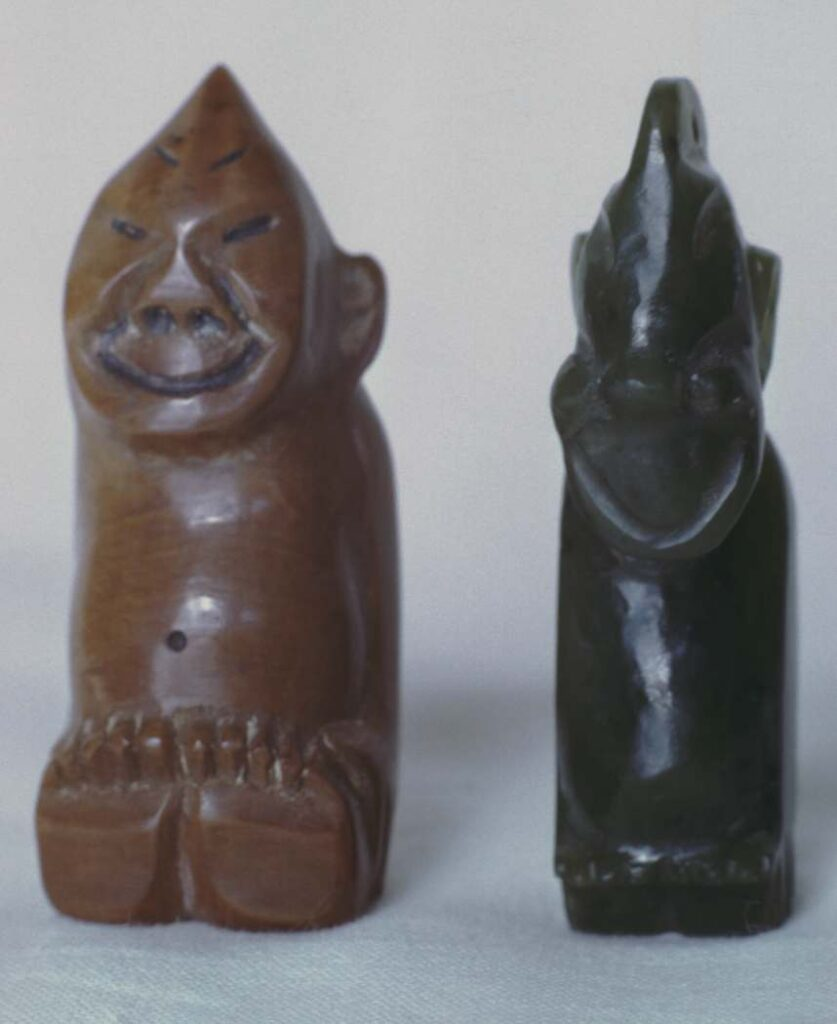 Left, figurine carved from mammoth ivory, two inches high, purchased in Wrangell about 1920. Right, pendant of nephrite, purchased in Whitehorse.