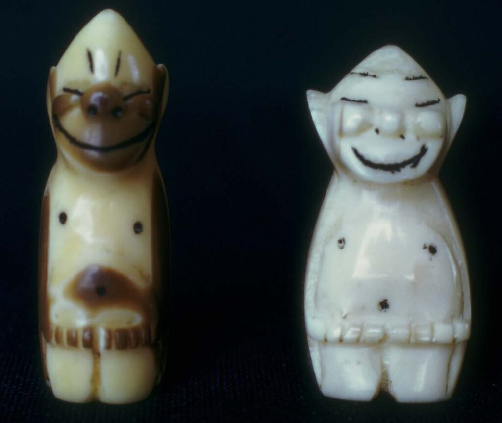 Figurines. Left, walrus ivory with natural coloration, an inch and five-eighths high. Purchased in Nome.